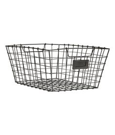 Black. Metal wire basket with handles at sides. Size 6 x 9 x 11 3/4 in.