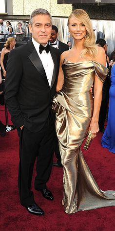 2012 Academy Awards: George Clooney and Stacey Keibler in a champagne-hued, off-the-shoulder Marchesa gown