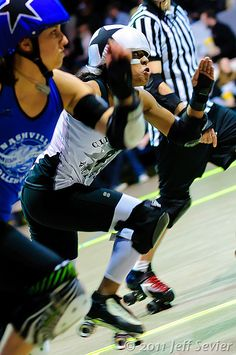 Nastee jamming for the Cincinnati Rollergirls,  versus the Nashville Rollergirls (uncertain the identity of the jammer - maybe Jersey Jackhammer?). Photo by Jeff Sevier.