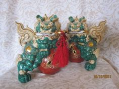 Japanese Kutani Pair with swords, jade green, 7 x 8 inches, $195.