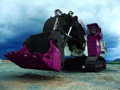 Big machine, scoops 57 yards per shovel. 9000 tons per hour. 2-16 cyl enginesgenerate 4400 hp