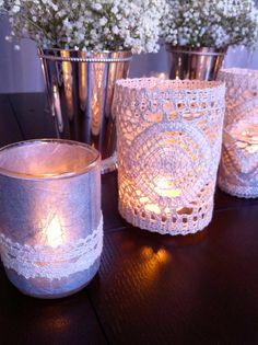 Create a visually appealing centerpiece with vintage lace votives. #winter weddings #centerpiece