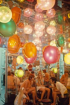 Women sit in a modern chic boutique in Casablanca, by Thomas J. Abercrombie, National Geographic Creative - Carefully selected by GORGONIA www. Parc A Theme, 70s Aesthetic, Jolie Photo, Retro Futurism, National Geographic Photos, National Geographic Photography, A Boutique, Cannes, Balloons