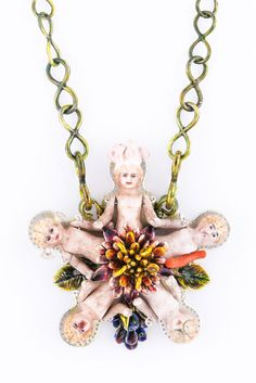 Serena Holm. Necklace: Sengen-Sama. Antique bisque doll parts, silver, glass, coral, enamel. 8 x 8 x 3 cm. Photo by: Holstr.se.