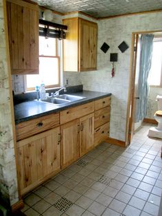 Kitchen in a tiny home cottage. A family of 4 lives in this tiny home!