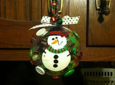 I love snowmen! So easy, just clear glass bulb, scrapbook paper, ribbon, christmas embellishments and acrylic paint! I wrote my kids name and the year on the ornament as well!