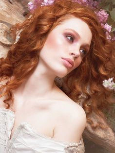 Finally, a beauty campaign featuring a natural [-looking?] redhead. With curly hair, no less! Gorgeous.