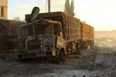 At least 18 of 31 lorries in the convoy were hit, according to a UN spokesperson. The convoy was intended to deliver aid for 78,000 people in rebel-held areas near Aleppo.  A witness told Reuters news agency by phone that about five missile strikes had hit the lorries, which were parked at a centre belonging to the Syrian Red Crescent. | Damaged aid trucks are pictured after an airstrike on the rebel held Urm al-Kubra town, western Aleppo city, Syria 20 September 2016.