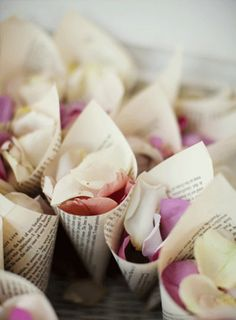 Rose petals add a more romantic feel to your send off and can be purchased in any color to match your theme. I like that this bride chose to include her love of books by using pages to create the cones.