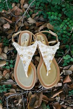 Kate Spade sandals encrusted with faux pearls and jewels prove that bridal beach footwear can be opulent and beautiful.