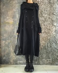 Coat By Rudholz, Top By Lilies, Sock Sneakers By Rick Owens, Bag With Sliver Details By Ma+.