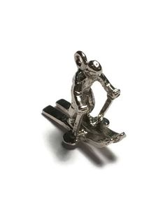 A personal favorite from my Etsy shop https://www.etsy.com/listing/254037619/sterling-silver-skier-charm-silver