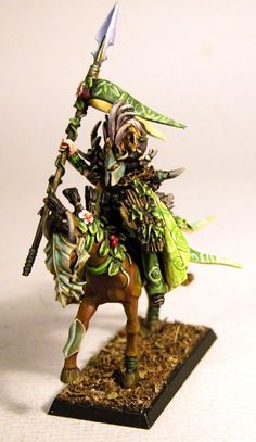 I really like the flowers! Very forest-y, but still fierce. Not so crazy about the mask.    IronHalo.net Miniature Painting - Wood Elf Lord - warhammer