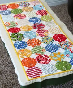 """Snowballs Summer tut by cluckclucksew, using charms and 1.75"""" x 1.75"""" squares in the corners. Sweet."""