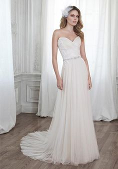 Patience by Maggie Sottero.  This stunning tulle sheath gown is accented with dainty lace appliqués on the bodice and a delicate Swarovski crystal waist. l TheKnot.com