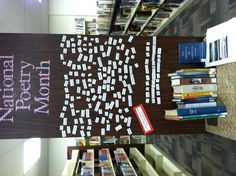 """National Poetry Month """"magnetic"""" poetry library display. Each of the staff picked a few lines from favorite poems and then we used contact paper and sticky tack! #trl"""