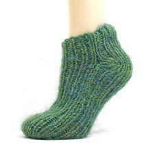 This is a super handy little knitting pattern to have on hand! Free Pattern: Simple 2-Needle Slipper Socks via the blog Not An Artist