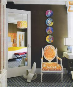 Unusual combination of super deep hued walls and super bright and vibrant elements.  The chair rocks...as does the banana!