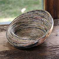 Recycled rolled paper glued into a bowl. How awesome is that?