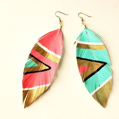 Neon Aztec - Faux Leather Feather Earrings - Electric Pink and Blue (Feathers have been re-appearing in a lot of magazines this season. I have invested in a few feather earrings and get many compliments) Aztec Earrings, Feather Earrings, Diy Earrings, Stud Earrings, Statement Earrings, Funky Earrings, Tribal Bracelets, Turquoise Earrings, Earrings Handmade