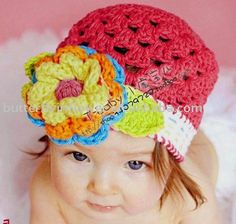 I love this for Addie...looks spring to me!  Crochet beanie with large bright flower