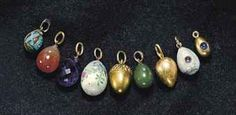 PROPERTY FROM THE DESCENDANTS OF GRAND DUCHESS XENIA ALEXANDROVNA: A GROUP OF NINE JEWELED, GOLD, SILVER, GLASS, HARDSTONE AND ENAMEL EGG PENDANTS, SOME BY FABERGÉ, VARIOUS DATE AND TOWN MARKS  Nine eggs, two inset with hardstone cabochons, three in guilloché or cloisonné enamel, hardstone, glass, silver or gold, with suspension loops. Provenance: Grand Duchess Xenia Alexandrovna, thence to Grand Duke Andrei Alexandrovich.