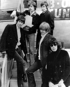 British rock and roll group The Rolling Stones arrive at Montreal Airport, April 22, 1965. They are Mick Jagger, top left, Charlie Watts, top right, Keith Richards, middle left, Brian Jones, middle right, and Bill Wyman. (AP Photo)
