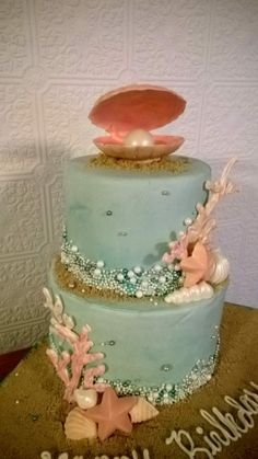 The Beach - * Vanilla Cake, Vanilla Butter cream, White Chocolate coral and shells, pearls, brown sugar sand.