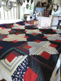 Antique handmade patchwork quilt throw bedspread.  Hand made from wool and cotton material with brushed cotton backing. Size: 77 x 66 inches.