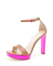 Love the two toned part of the shoe. I usually like a thin heel but the color/accent is fabulous