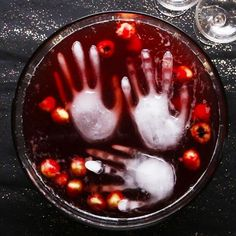 Halloween Party Punch Recipe by Tasty - Delivery Food - Ideas of Delivery Food - Heres what you need: lychees in syrup blueberries red food coloring cranberry juice ginger ale reserved lychee juice vodka food-safe glove Punch Halloween, Entree Halloween, Dessert Halloween, Halloween Appetizers, Halloween Food For Party, Halloween Party Decor, Appetizers For Party, Halloween Treats, Spooky Halloween
