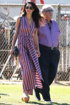 She just can't stay away! Amal Clooney has been a regular on the set of Suburbicon, the upcoming mystery movie that George Clooney is directing, and she was there again yesterday, looking as fashionable as ever. If the 38-year-old human rights lawyer continues to dress this flawlessly when stopping