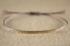 Minimalist Friendship Thread Bracelet with 42 Small Gold Beads  - Choose your Colour. $27.95, via Etsy.