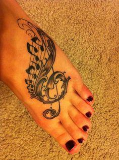 Men treble clef tattoo spider
