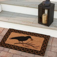 """Crow Star Doormat by Park Designs, a favorite of homeowners, will elegantly greet the guests of your home. Mats are made from natural coir fibers, hand painted with colorfast non-toxic dyes, durable, mildew and skid resistant. Size: 29"""" x 17""""."""