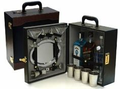 Two Tone Three Bottle Bartender's Cocktail Bar Travel Bar With Tools by Trav L Bar. $69.95. Pair of martini glasses. Four metal cups. 1.5oz jigger, two speed pourers, and a bottle opener. Quality combination lock. Serving tray. Two tone exective style travel bar offers offers room for three of your favorite bottles (standard fifth sizes).  Combination lock, standard serving tray, bottle opener, martini glasses, speed pourers, and double sided jigger.   Great for yourself, g...