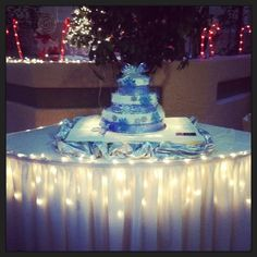 Winter Wonderland Wedding Cake dazzling with snowflakes at the Viscount Suite Hotel.