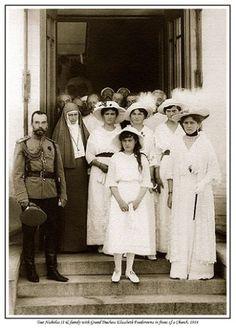 Imperial family 1913. Tsar Nicholas II, his wife Empress Alexandra with their daughters. Empress Alexandra's sister Grand Duchess Elizabeth (Ella) is standing behind Nicholas II.