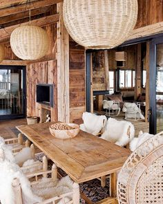 Former Farmhouse Converted into Sophisticated, Yet Bohemian Chalet in the Alps #wood #dining #terrace