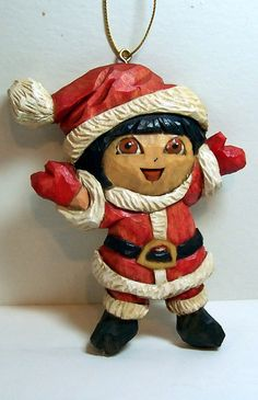 Dora Christmas ornament carved from basswood