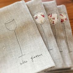 Cute applique and embroidery on linen tea towels.