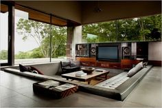 Fantastic Living Room Idea but there is a problem with putting stuffs on the floor... I'm afraid I'll kick it