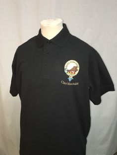 Cotton polo shirt with embroidered crest of clan MacAulay. Size XL, black. Clearance item.