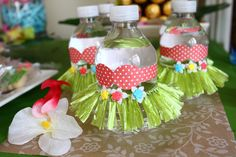 Love these decorated water bottles at a Hawaiian Luau Birthday Party!  See more…