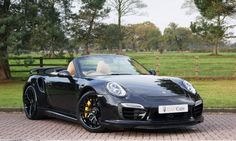 Maybe a Porsche 911 Turbo S Cabriolet I like a convertible
