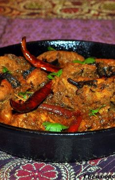 Jaipuri Chicken Curry: 2 1/4 lb (1 Kg)- Chicken 12 - Dry whole Red chilly 1 Tsp - Cloves 1 1/4 C - Yogurt 2 Tsp - Cumin Seeds(Roasted) 1 1/2 Tbsp - Coriander powder 3/4 Tsp - Red Chilly Powder  3 Bay leaves 6 - Green Cardamom pods 5 - Black Cardamom pods 15 - Garlic cloves (Finely Chopped) 1 3/4 C - Red Onions (Finely Chopped) 3 C - Chicken Stock or water Cilantro / Coriander leaves for garnish Salt to taste Oil  For Tadka/ Seasoning 3 - Red chilly 3- Cloves