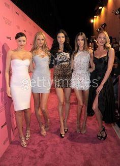 Candice Swanepoel wearing Mcs Spikey Bracelet, Dolce & Gabbana Spring 2011 Rtw Satin Mini Dress and Dolce & Gabbana Spring 2011 Long Black Skirt.