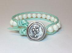 Swarovski Ivory Pearl on Mint Leather Cord w/ by DesignsByJen1, find glass pearls at http://www.ecrafty.com/c-595-glass-pearls.aspx