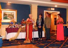 Caledonian Club of West Floirida President Phyliss McIlraith presents award to Dolly Jacob and  Pedro Reis  who mentor Sailor Circus students in the art of circus performances flanked by Sarasota Sister City's director of relations with Dunfermline, Pauline Mitchell.   The Caledonian Club of West Florida has been an alliance member of Sister Cities Association of Sarasota since 2002.