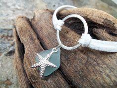 Sea glass jewelry,  Pretty blue sea glass with starfish charm on white suede bracelet.